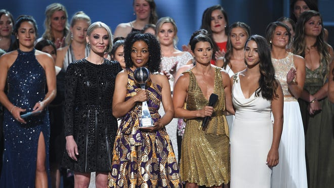 """Host Danica Patrick, Sarah Klein, Tiffany Thomas Lopez, Aly Raisman and other """"sister survivors"""" of Larry Nassar's sexual abuse who were recipients of the Arthur Ashe Award for Courage speak onstage at The 2018 ESPYS at Microsoft Theater on July 18, 2018 in Los Angeles, California."""