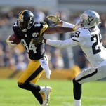 Nov 8, 2015; Pittsburgh, PA, USA; Pittsburgh Steelers receiver Antonio Brown (84) is defended by Oakland Raiders cornerback David Amerson (29) in a NFL football game against the Oakland Raiders at Heinz Field.