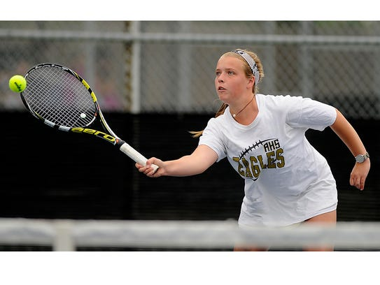 Abilene High's Rachel Tebow returns a ball during her