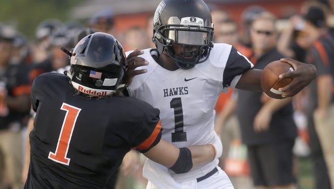 Lakota East quarterback TJ Jemison is tackled by Loveland linebacker Calvin Whitaker on Friday.