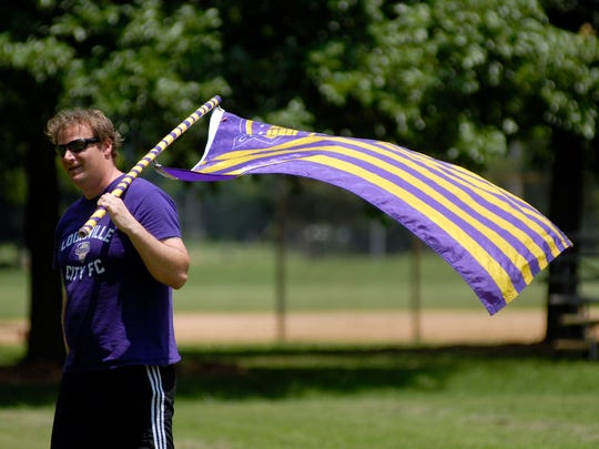 Ken Luther waves the team flag at the fan support game at Seneca Park, the Louisville City Football Club's Coopers versus The Cincinnati fan support group, The Pride.  June 25, 2016