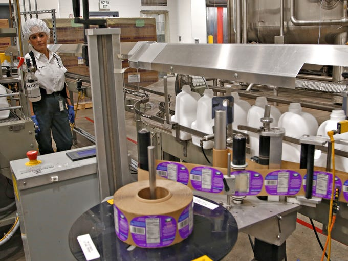Empty jugs are labeled first on the production line