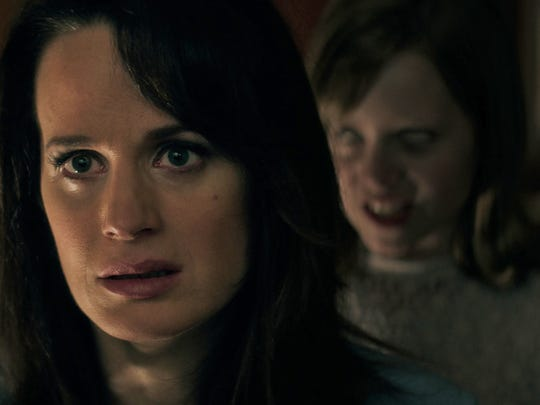 "Mom, I think there's something wrong with Doris: Alice (Elizabeth Reaser) is seemingly unaware of what's happening to her youngest daughter (Lulu Wilson) in ""Ouija: Origin of Evil."""