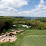 Players face a 100-foot drop in elevation on the 114-yard second hole at Top of the Rock in Ridgedale. The course is hosting the Bass Pro Shops Legends of Golf at Big Cedar Lodge this weekend.