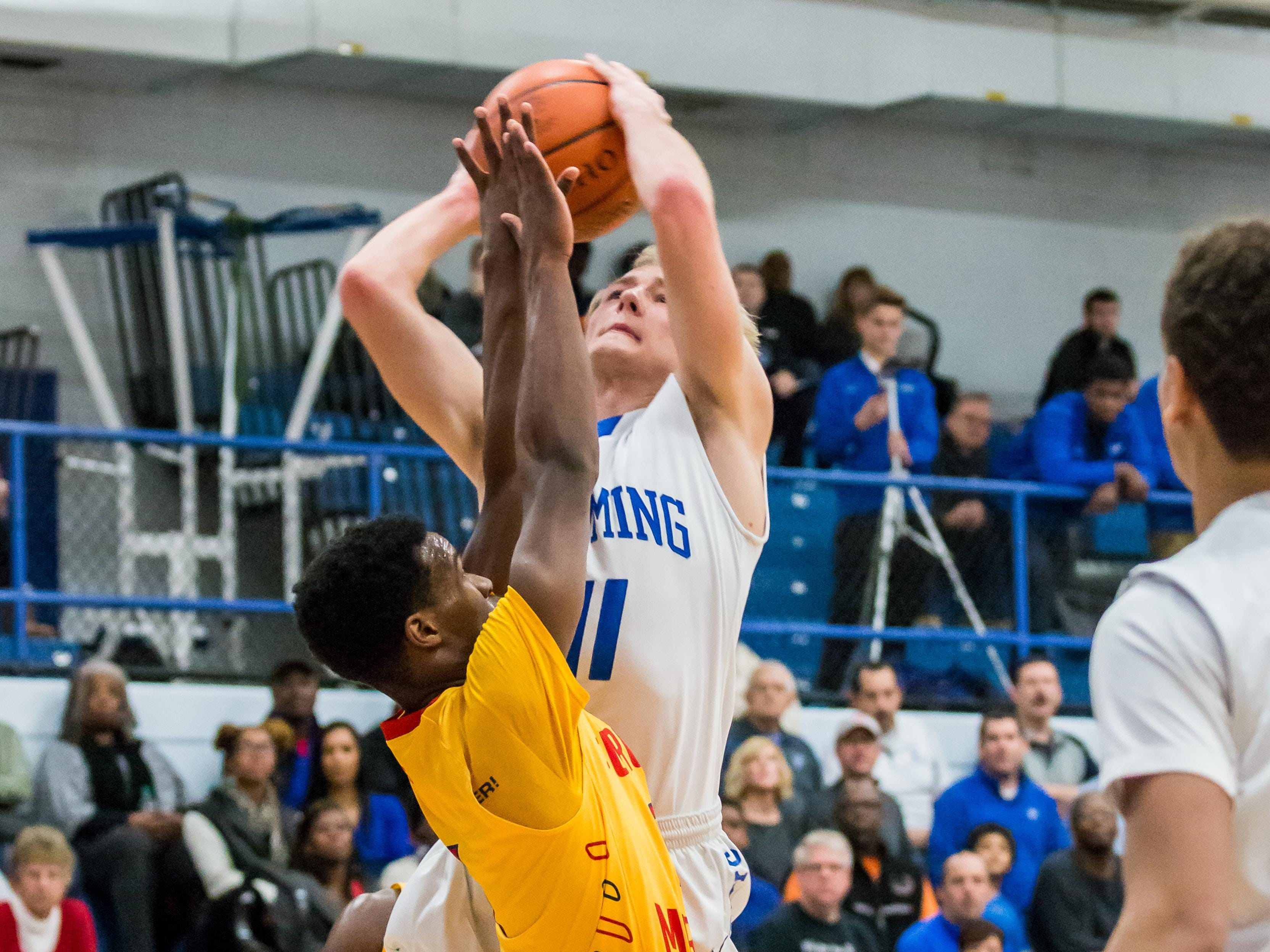 Wyoming's Mason Rogers goes to the rack against Purcell Marian.