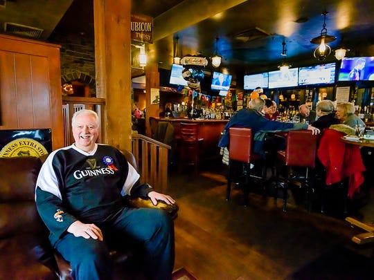 Craig Larsen sits in Claddagh Irish Pub during his