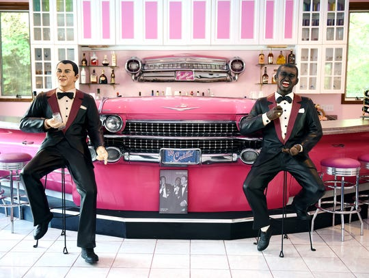 Statues of Frank Sinatra, left, Sammy Davis Jr., and