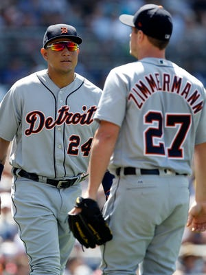 Tigers first baseman Miguel Cabrera talks with starting pitcher Jordan Zimmermann during the fourth inning on Sunday.