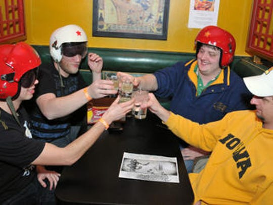 Fong's customers toast to their ridiculous headgear.
