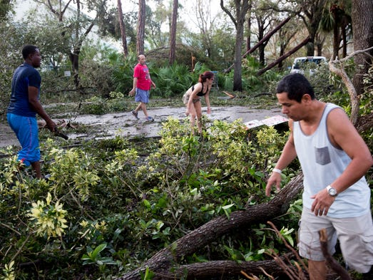 Residents of Windsong Club Apartments clear the main