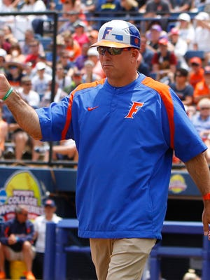FILE - In this May 31, 2015, file photo, Florida's head coach Tim Walton gestures to one of his players in the fourth inning during an NCAA Women's College World Series game against Auburn in Oklahoma City. Florida softball coach Tim Walton was involved in an altercation with Auburn shortstop Haley Fagan on Monday night, March 27, 2017, after Walton gave Fagan a slight push during postgame handshakes. (AP Photo/Alonzo Adams, FIle)