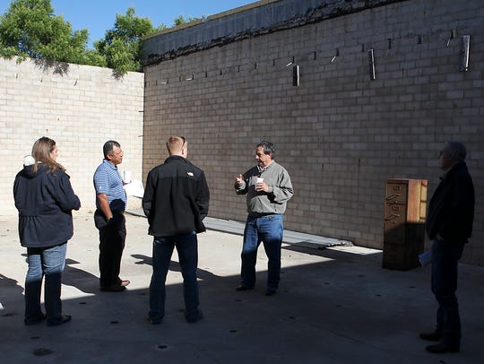 Local city and business officials visit the empty Eden