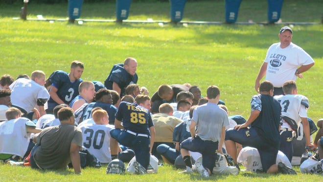 Lloyd coach Eric Turner addresses the team after practice.