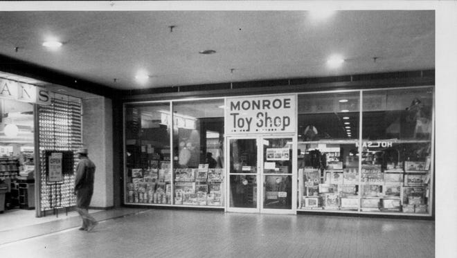 Monroe Toy Shop pictured at Midtown Plaza in 1977 near Wegmans, which was expanding its space.