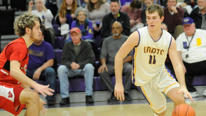 Unioto's Brandon Kennedy dribbles at the top of the key during the third quarter of Saturday's 74-49 win over Jackson at Unioto High School.