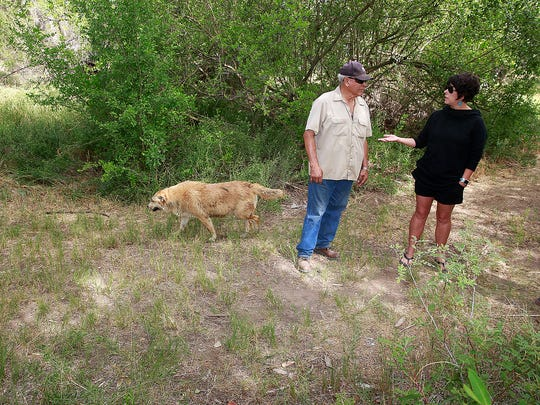 Larry Garcia and his daughter, Amanda Garcia, stand on part of their property the city of Farmington wants to annex for a river trails expansion on Wednesday near the West Murray Drive bridge over the Animas River.