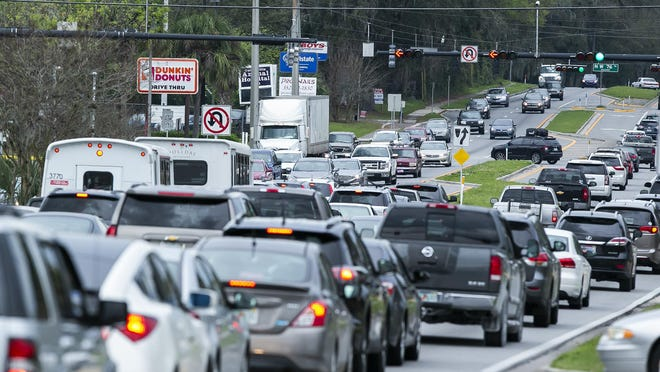 Traffic backs up just west of Interstate 75 on Newberry Road on a Friday afternoon.