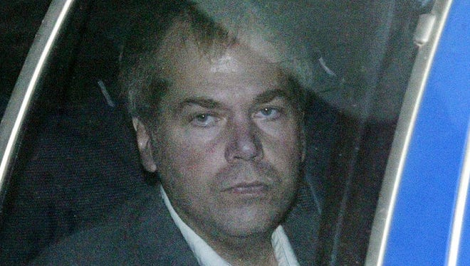 A federal court judge rules that John Hinckley Jr., the would-be assassin of President Reagan, no longer poses a danger and can be freed into the custody of his mother. Hinckley, 61, is seen here in a 2003 file photo.