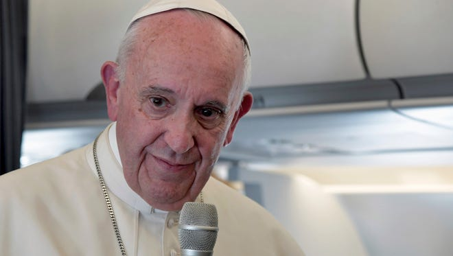 Pope Francis addresses journalists during the traditional press conference on his flight back to Rome, following a two-day visit at Fatima, Portugal, on May 13, 2017.
