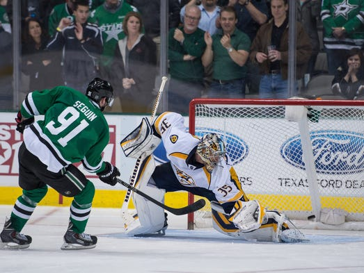 Dallas Stars center Tyler Seguin (91) scores the game winning goal against Nashville Predators goalie Pekka Rinne (35) during the overtime shootout at the American Airlines Center. The Stars defeated the Predators 3-2 in the overtime shootout.