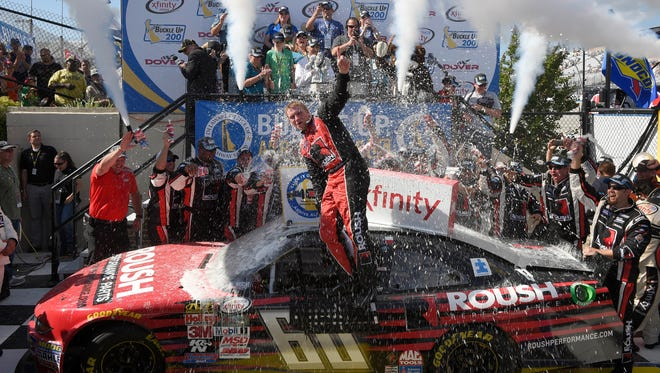 Chris Buescher celebrates in Victory Lane after winning the NASCAR Xfinity series race on Saturday at Dover International Speedway.