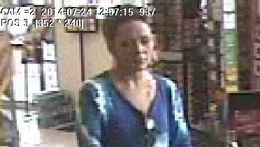 Police are looking for a woman captured on surveillance video involved in an auto theft.