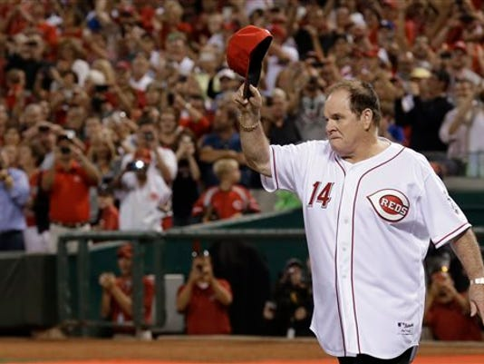 Former Cincinnati Reds great Pete Rose walks onto the field during ceremonies honoring the starting eight of the 1975-76 World Series-champion Reds, following a baseball game between the Reds and the Los Angeles Dodgers, Friday, Sept. 6, 2013, in Cincinnati.