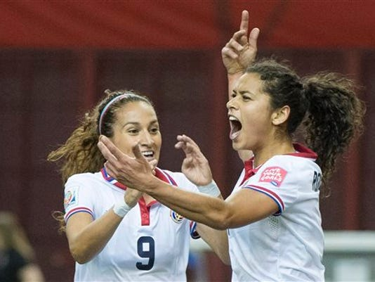 FILE - In this Tuesday, June 9, 2015, file photo, Costa Rica's Raquel Rodriguez Cedeno, right, celebrates with teammate Carolina Venegas (9) after scoring against Spain during the first half of a FIFA Women's World Cup soccer game in Montreal, Canada. Rodriguez Cedeno, a senior at Penn State's, is among several current U.S. college players who are playing for other nations in the World Cup, which is being played over the next month in six Canadian cities. (Graham Hughes/The Canadian Press via AP, File) MANDATORY CREDIT
