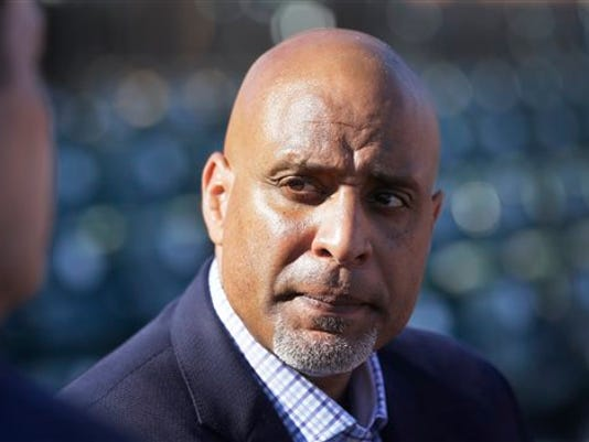 FILE - In this March 17, 2015, file photo, Tony Clark, executive director of the baseball players' union, talks to reporters before a spring training baseball game between the Detroit Tigers and the Washington Nationals in Lakeland, Fla.