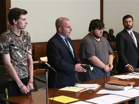 Kevin Norton, left, and James Stumbo, second from right, appear for their dangerousness hearing with attorneys John O'Neill, second from left, and Steven Goldwyn, right, at Boston Municipal Court, Tuesday, Sept. 1, 2015.