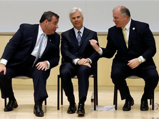 New Jersey Senate President Stephen M. Sweeney, D-West Deptford., right, gestures as New Jersey Gov. Chris Christie, left, talks with influential Democrat George E. Norcross III, at a 2014 groundbreaking ceremony in Camden, for the KIPP Cooper Norcross Academy school that Norcross' family foundation is funding. Many of Christie's recent tax involve projects connected to Norcross, the Democratic power broker.
