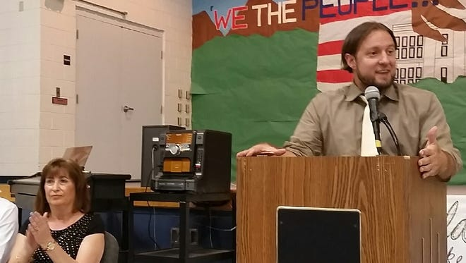 "New Mexico Public Education Secretary Christopher Ruszkowski, right, told attendees at a Mesquite Elementary School assembly on Thursday, Sept. 7, 2017, that the school district should be seen as a ""model"" for the state because of its improvements in student performance. School Principal Angela Silvaggio looks on."