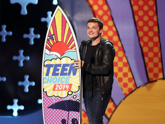 "Josh Hutcherson accepts the award for choice movie actor: sci-fi/fantasy for ""The Hunger Games: Catching Fire"" at the Teen Choice Awards at the Shrine Auditorium on Sunday, Aug. 10, 2014, in Los Angeles."