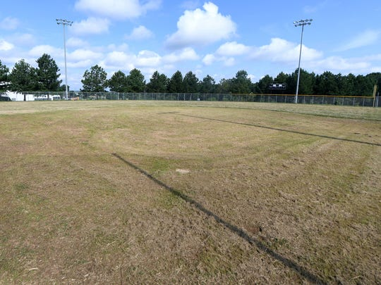 Grass has grown and covered the entire softball field at Liberty Tech Magnet School.