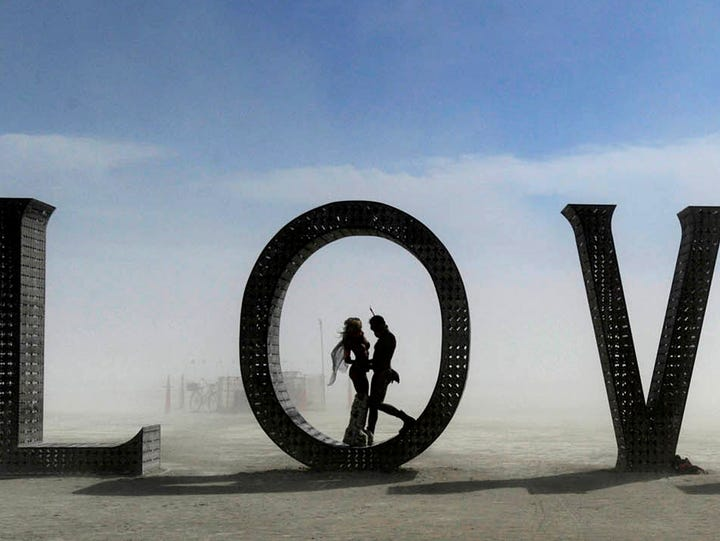 Images of Burning Man participants on the Black Rock