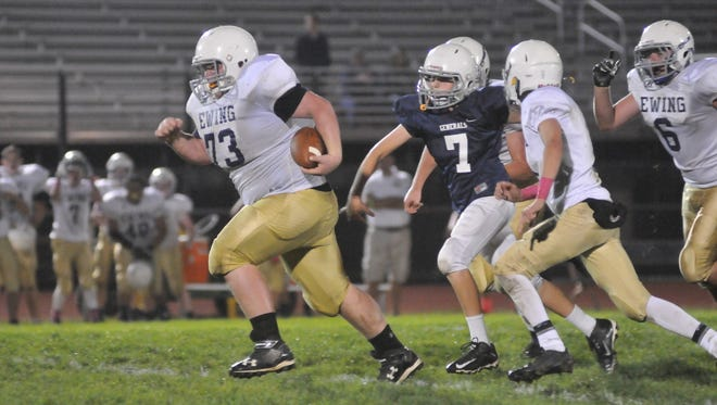 Ewing's Dalton Golden out runs the Sherman defense on the way to a touchdown Wednesday at Fulton Field in Lancaster. The city's two public junior high school's faced off for their annual football game Wednesday.
