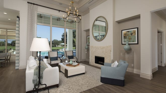The Aqualina grand estate by Stock Signature Homes is one of 10 furnished grand estate models that are completed or actively under construction at Quail West.  Twenty-four buildable grand estate home sites featuring long range water, fairway, and preserve views are also available.
