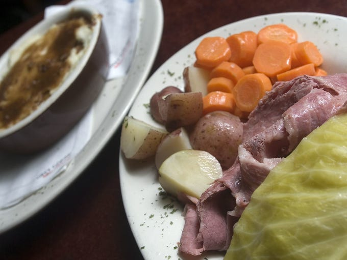 Corned beef and cabbage with potatoes, carrots and