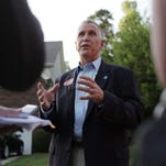 "U.S. Senate candidate Thom Tillis speaks with media after he and his wife, Susan, participate in the ""Get Out the Vote"" efforts in the Northstone Country Club neighborhood in Huntersville, on Monday."