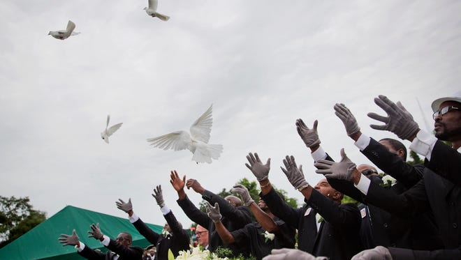 Pallbearers release doves over the casket of Ethel Lance during her burial service, the first one for the nine people killed in the shooting at Emanuel AME Church.