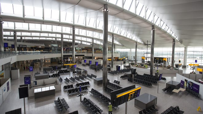 In this photo from April 23, 2014, a man walks in the under-construction departure lounge of Heathrow airport's new Terminal 2.