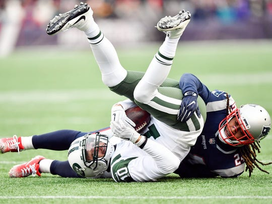 New England Patriots cornerback Stephon Gilmore (24) tackles New York Jets wide receiver Jermaine Kearse (10) during the second half at Gillette Stadium on  Dec 31, 2017 at Foxborough, Mass.