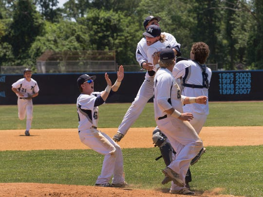 Manasquan rush to mound to celebrate their victory. Manasquan vs Whipping Park in NJSIAA Group II Baseball Championship in Toms River, NJ on June 10, 2017.