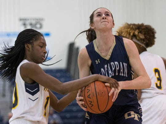 Franklin's Kennady Schenck tries to strip ball from NV/Old Tappan's Noelle Gonzalez. NV/Old Tappan vs Franklin Girls Basketball in NJSIAA quarterfinal game at Toms River on March 14, 2018