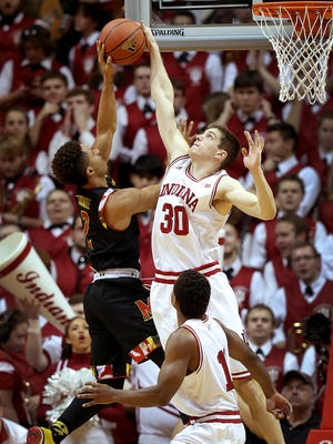 Indiana Hoosiers forward Collin Hartman (30) blocks the shot by Maryland Terrapins guard Melo Trimble (2) in the second half of their game. The Indiana Hoosiers defeated the Maryland Terrapins 89-70 Thursday, January 22, 2015, evening at Assembly Hall in Bloomington IN.