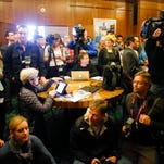 Representatives of Oregon and national news media crowd the lobby of the Governor's Office at the state Capitol on Friday in the expectation that Gov. John Kitzhaber will personally announce his resignation. Instead, he issued a statement and a voice recording.