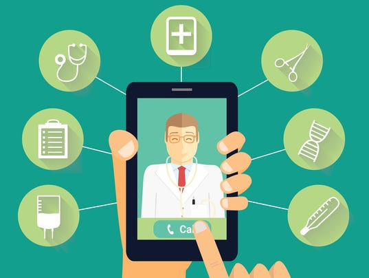 Call to doctor concept. Hand holds phone with smiling doctor.