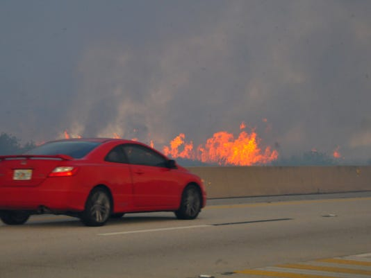 Brush fire west of I-95