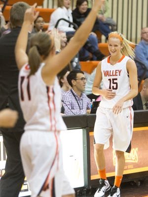 Valley's Grace Vander Weide, right, finished with a game-high 29 points, including a 60-foot heave to end a dominant third quarter, as the third-ranked Tigers beat No. 7 Centennial on Tuesday.