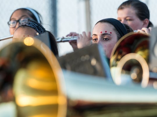 Members of James M. Bennett's marching band perform at Wicomico County Stadium during a game against Parkside on Friday, Oct. 6, 2017.